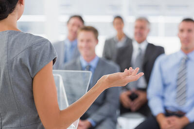 Businesswoman doing conference presentation in meeting room