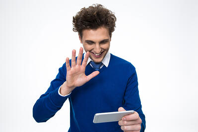 Happy business man using smartphone over white background