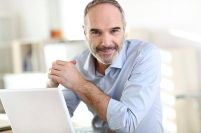 Senior businessman working on laptop computer-1