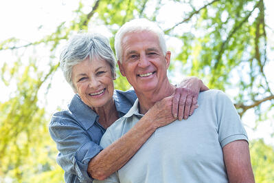 Happy old couple smiling in a park on a sunny day-1